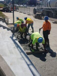 Longs Peak Middle School workers installing concrete front steps